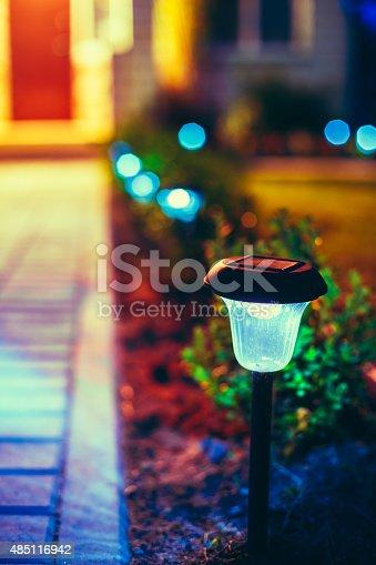 498598201 istock photo Small Solar Garden Light, Lantern In Flower Bed. Garden Design. 485116942