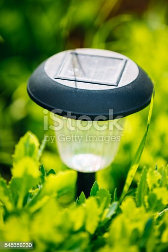 498598201 istock photo Small Solar Garden Light, Lantern In Flower Bed. Garden Design. 545356230