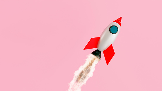 Launch of a space ship. The shuttle travels up in the air. Concept of launching something new with success.
