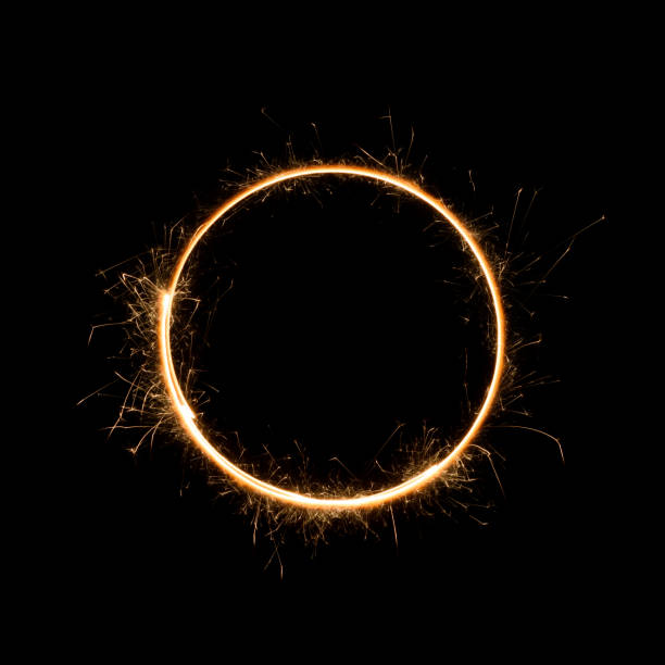 Small sparkler circle isolated Small sparkler circle. Burning bengal fire round letter o number zero, isolated on black. pyrotechnic effects stock pictures, royalty-free photos & images