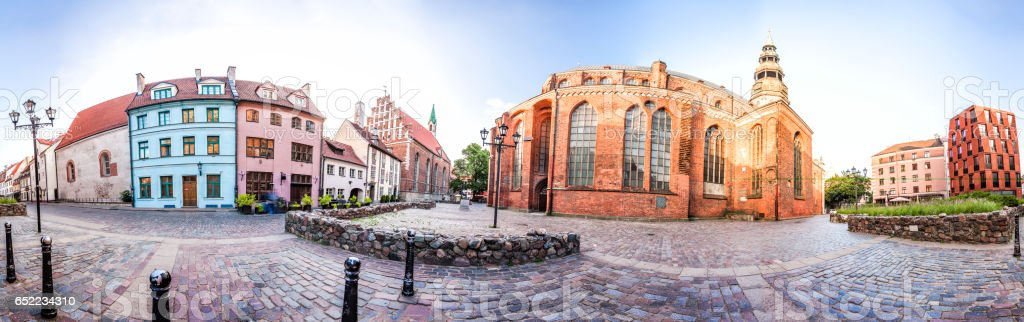 Small Square with Old houses near the St. Peter Church, Riga stock photo