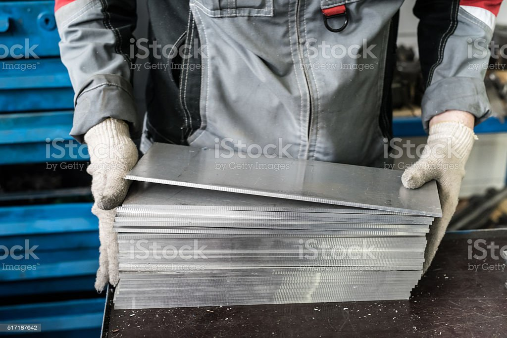 small stack of steel plates on the bench miller stock photo