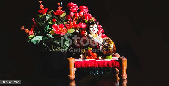 Small statue of Lord Krishna.Krishna is a major deity in Hinduism. He is worshipped as the eighth avatar of the god Vishnu and also as the supreme God in his own right.