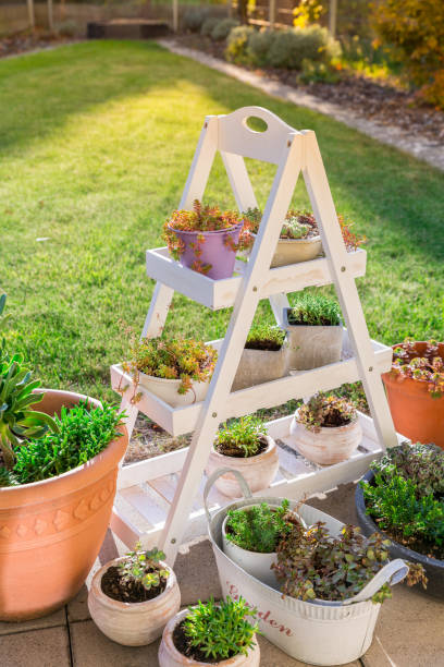 Small stone garden with garden shelf and pottery stock photo