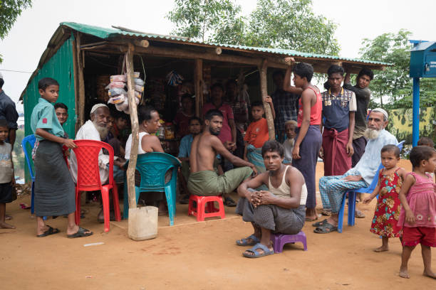 Small store at Rohingya refugee camp in Bangladesh Rohingya Muslims from Myanmar socialize outside a rustic shop built at Kutupalong refugee camp in Bangladesh. An estimaged 600,000 Rohingya fled Myanmar in the two months since August 25. (October 29, 2017) rohingya culture stock pictures, royalty-free photos & images