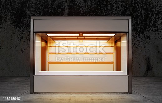 empty small store on street of city at night time