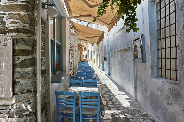 Small street on the island Tinos in Greece stock photo