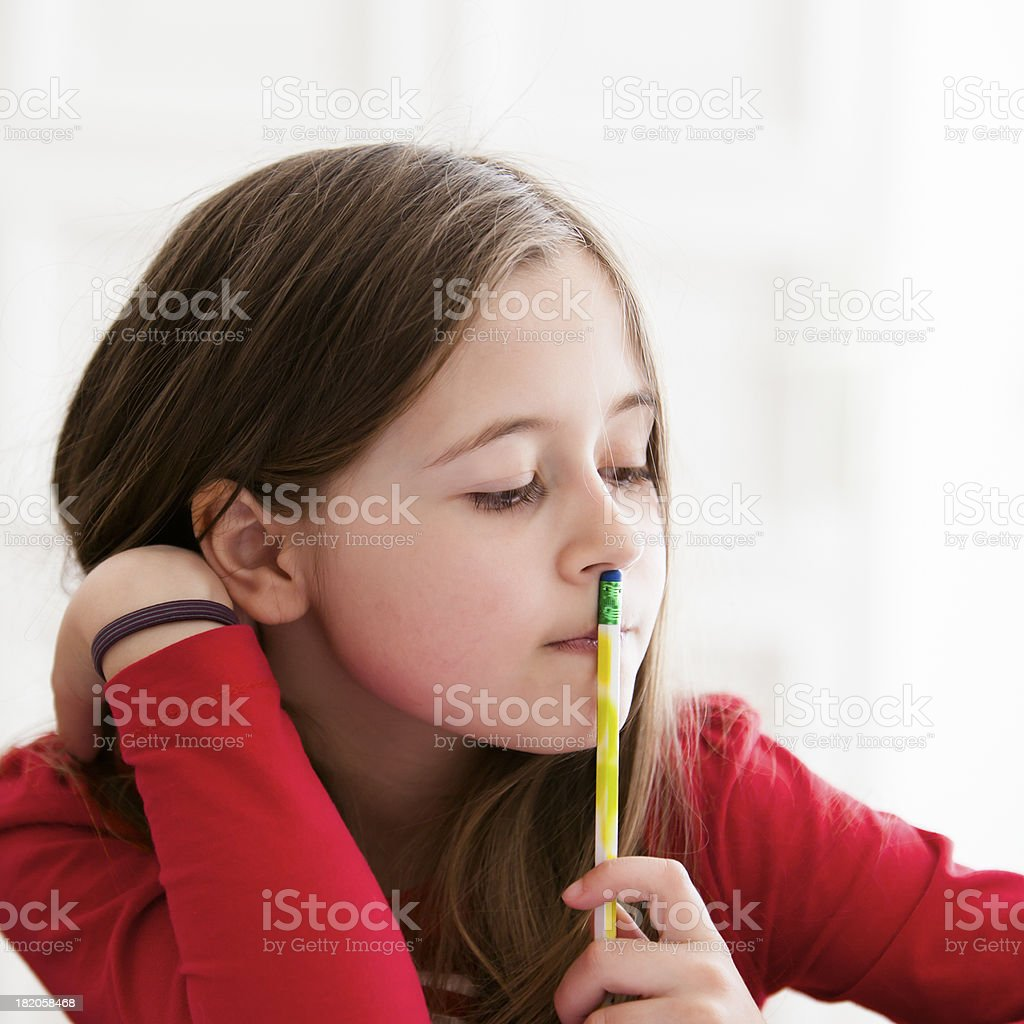 Small student thinking stock photo