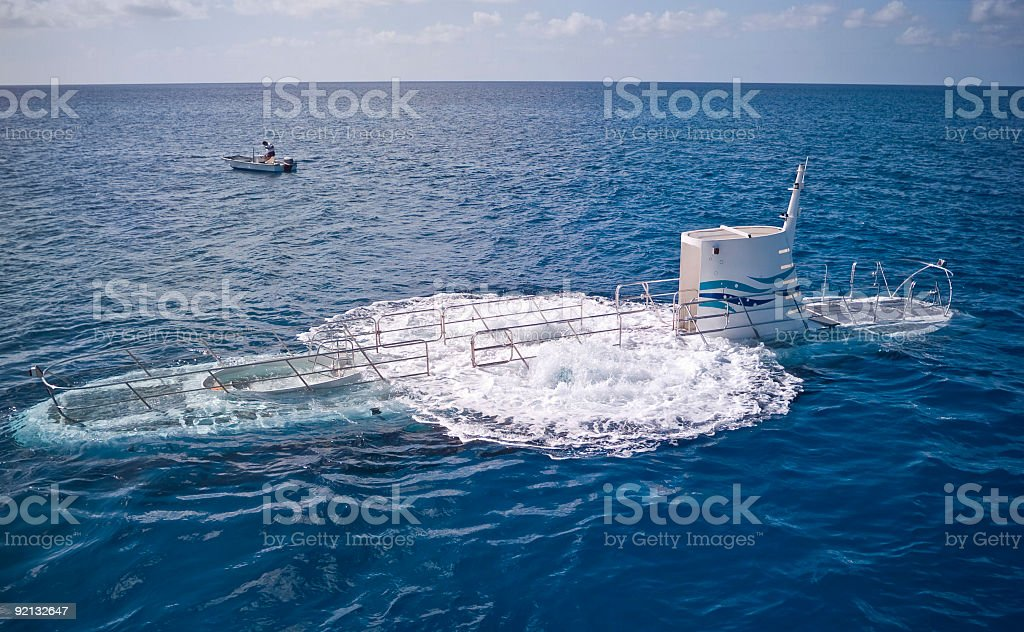 Small Submarine Submerging In The Caribbbean Stock Photo