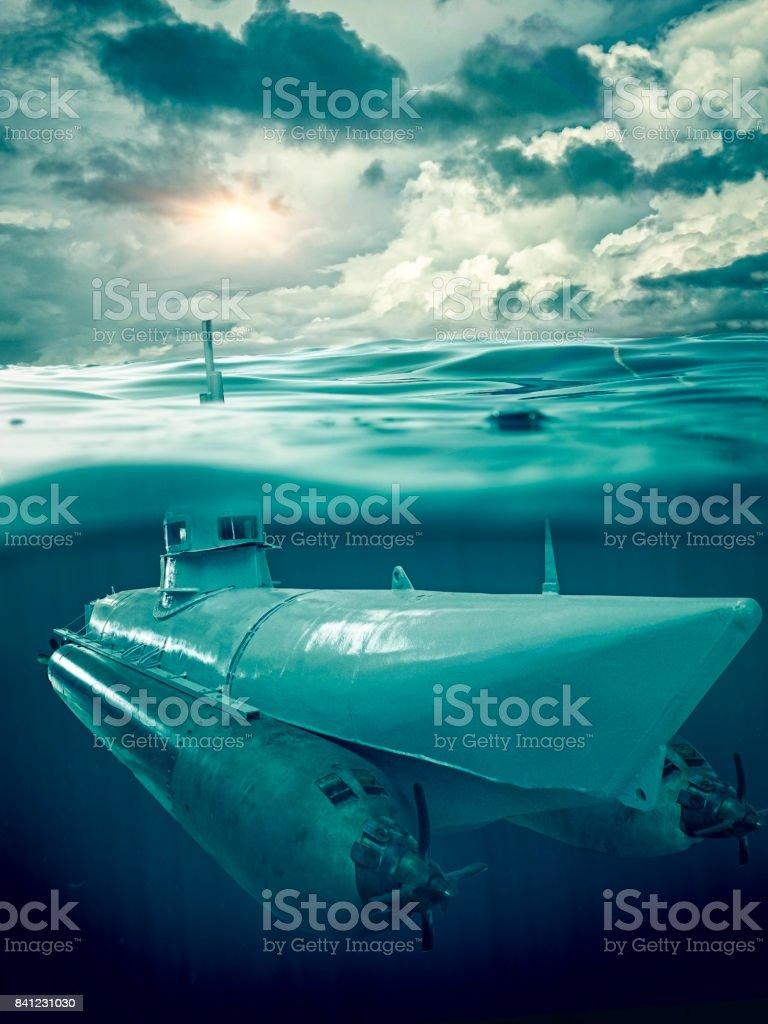 Small submarine supervises the sea stock photo