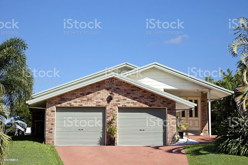 Small Suburban Home with blue sky stock photo