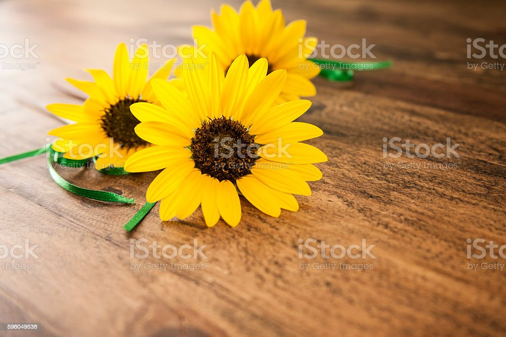 Small sunflower bouquet on wooden table. royalty-free stock photo