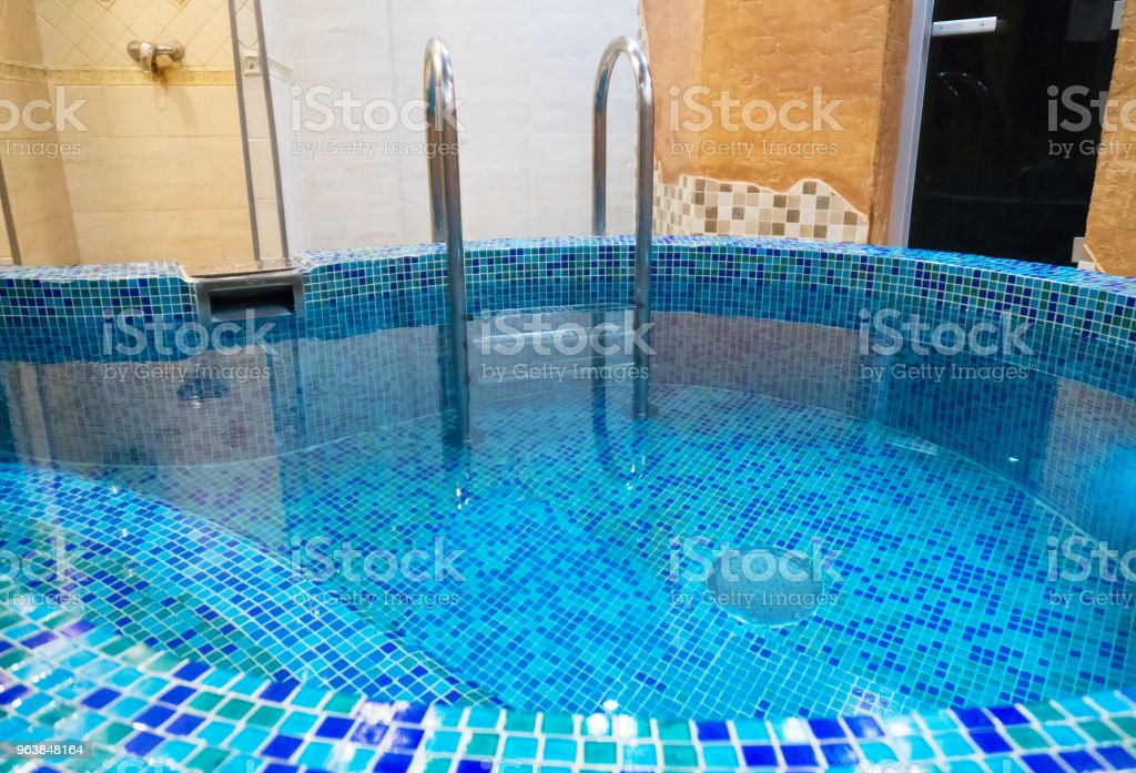 Small swimming pool with a bench in the sauna. - Royalty-free Bathhouse Stock Photo