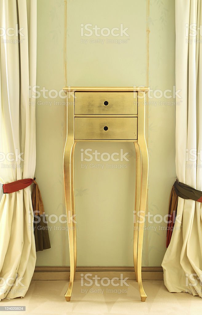 small table between the curtains of beautiful suites royalty-free stock photo