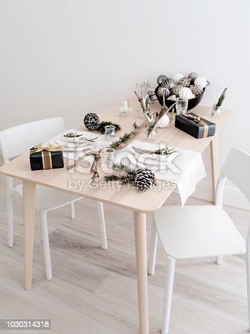 istock Small table for couple set for New Year celebration. 1030314318