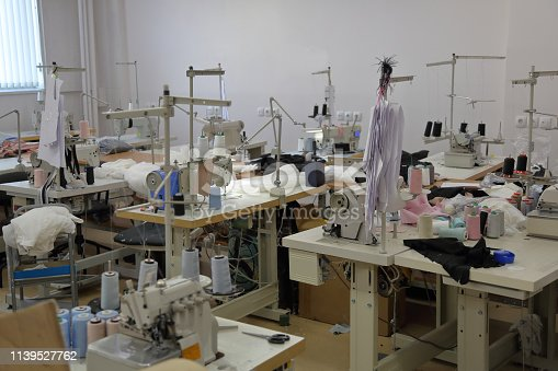 A small workshop for sewing clothes with professional equipment and tools