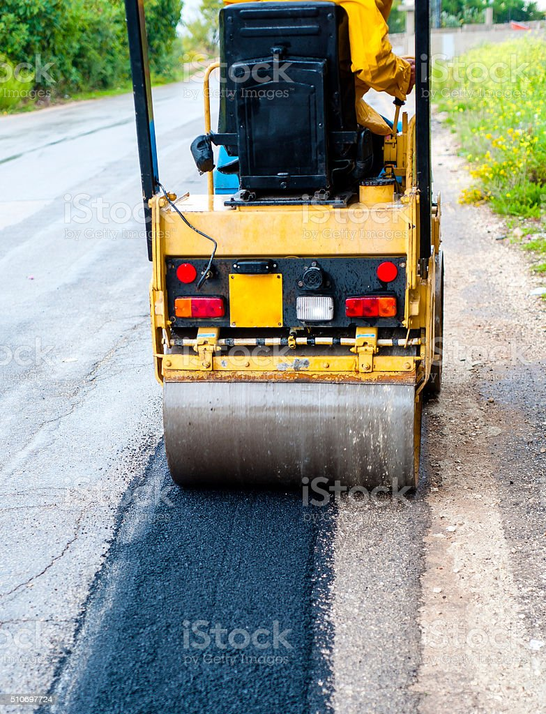 small tandem vibration roller compactor stock photo
