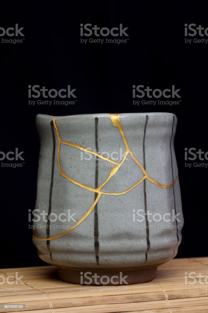 Small tea cup with kintsugi repair. stock photo