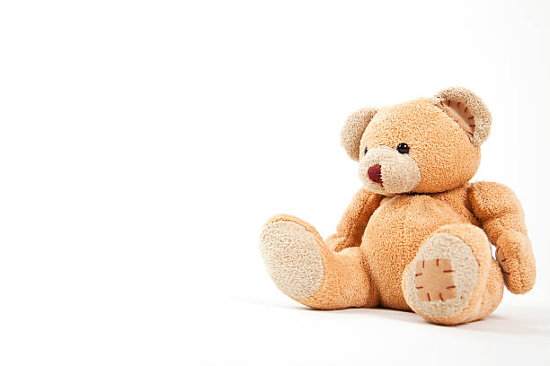 small teddy bear isolated on white  - toy stock pictures, royalty-free photos & images