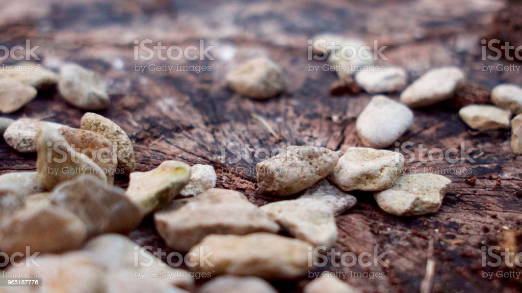 Small to medium size stones, light coloured pebbles and gravel in shades of brown. zbiór zdjęć royalty-free