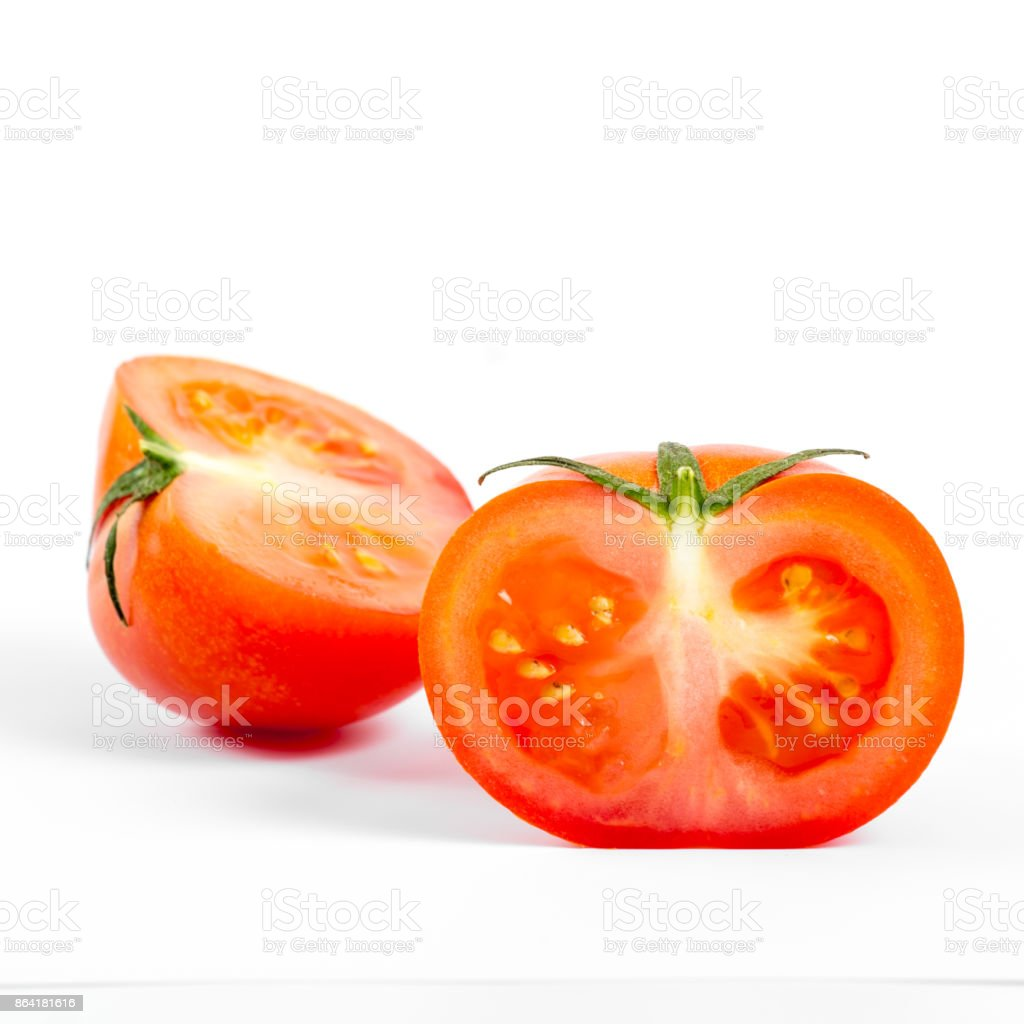 small tomato cut, close-up, on white background royalty-free stock photo