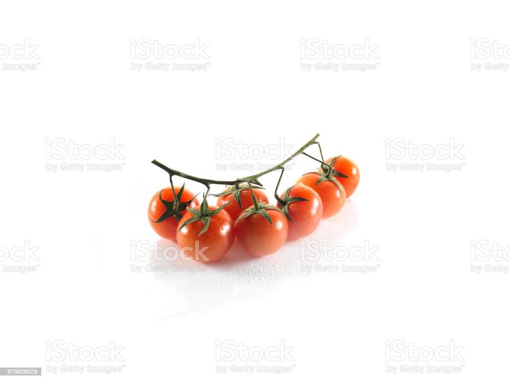 kleine Tomaten auf weißem Hintergrund - Lizenzfrei Abnehmen Stock-Foto