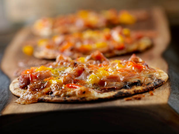 Small Tortilla Pizzas with Sausage and Peppers stock photo