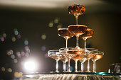 small tower of champagne's glass in wedding reception party