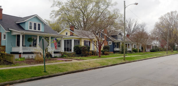 Small Town America Neighborhood Residential neighborhood block of home on dreary rainy spring afternoon. americana stock pictures, royalty-free photos & images