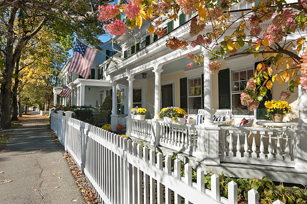 Small town America street scene A view of some antique houses, dappled with warm autumn sunlight, in the charming town of Woodstock, Vermont. colonial style stock pictures, royalty-free photos & images