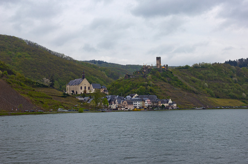Small town Beilstein and castle ruins on the Mosel bank in Rhineland-Palatinate on rainy day, Germany