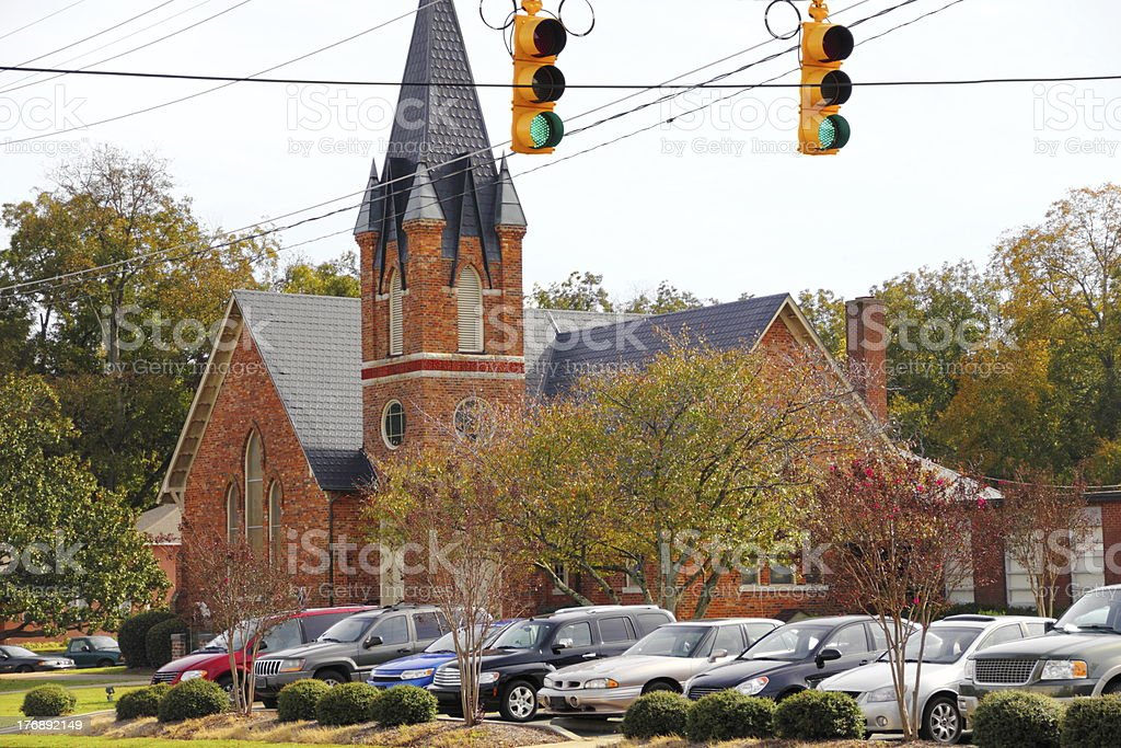 Small Town Brick Church with Full Parking Lot stock photo