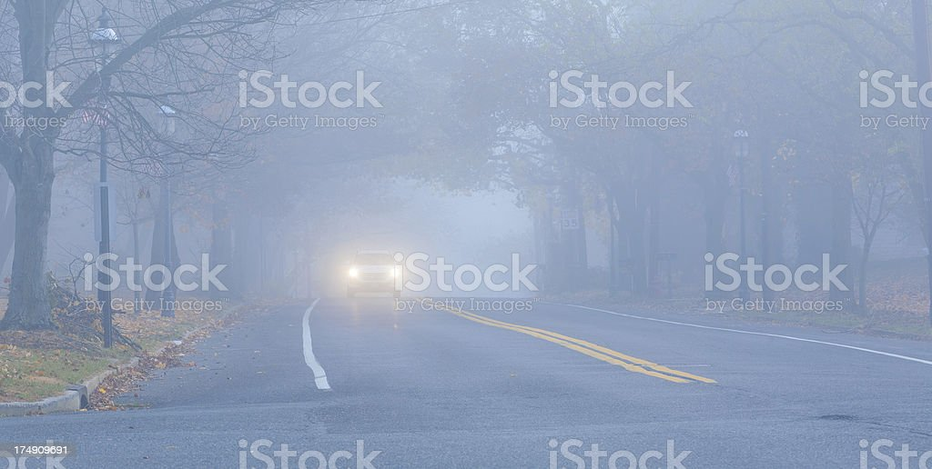 Small town community highway in the fog royalty-free stock photo