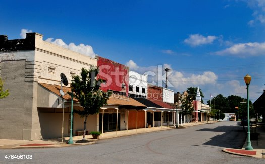 Downtown area of small town in south Arkansas, USA, with most of the storefronts boarded up.