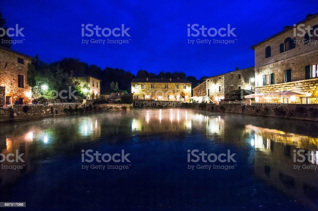 Small town famous for its hot water springs in Tuscany, Bagno Vignoni. stock photo