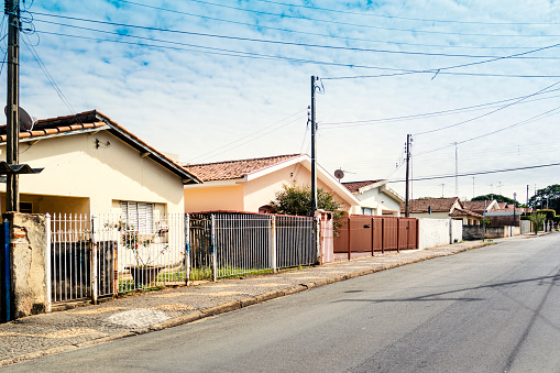 Photo of a street with traditional houses in Brazil. Small town.
