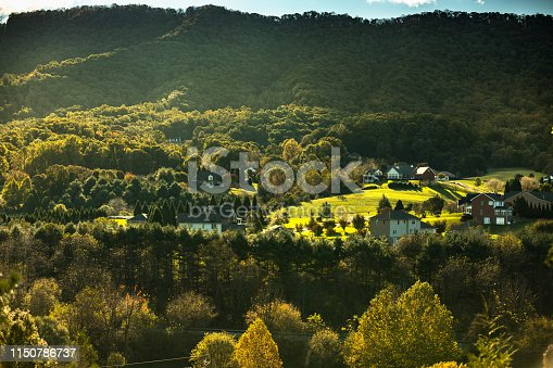 Tree covered hills and cottages of the Blue Ridge Mountains in North Carolina USA