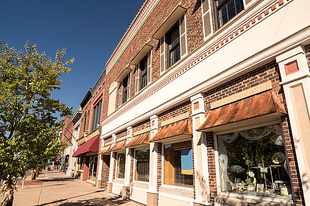Small Town Main Street A photo of a typical small town main street in the United States of America. Features old brick buildings with specialty shops and restaurants. americana stock pictures, royalty-free photos & images