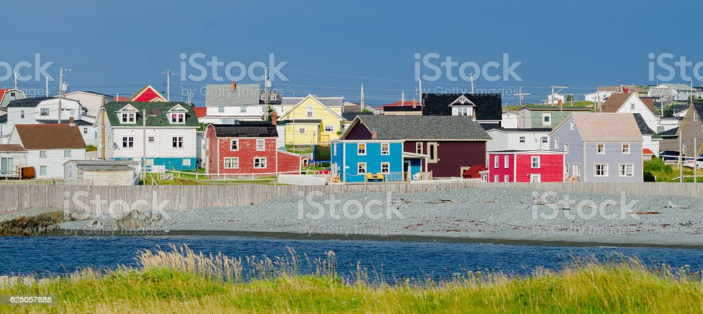 Small town Newfoundland.  Multi color houses everywhere. stock photo