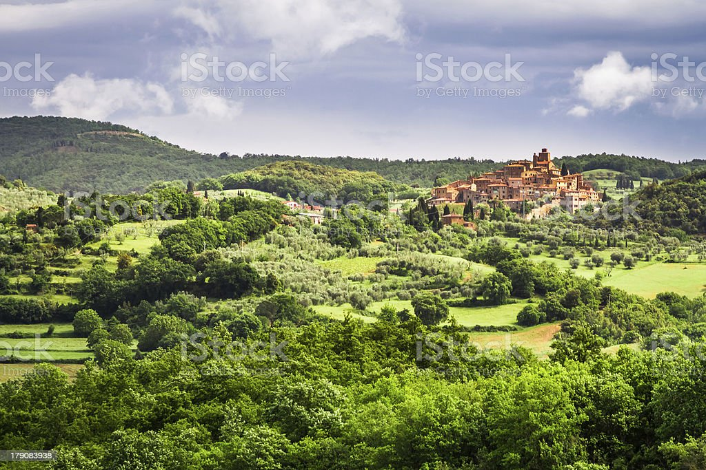 Small town on a hill in Tuscany royalty-free stock photo
