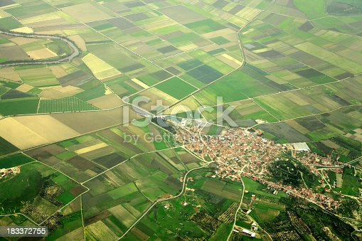 elevated view of farm fields and small town in Izmir, Turkey.