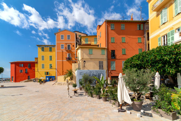 Small town square and colorful houses in Menton. stock photo