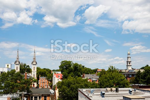 istock Small Town Steeples and Rooftops, Cloud Filled Skies 588991522