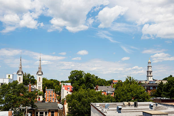 Small Town Steeples and Rooftops, Cloud Filled Skies stock photo