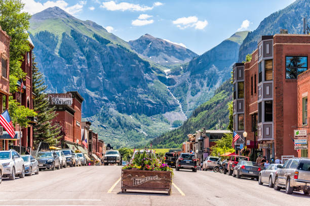 small town village in colorado with sign for city and flowers by historic architecture - vacations food stock pictures, royalty-free photos & images
