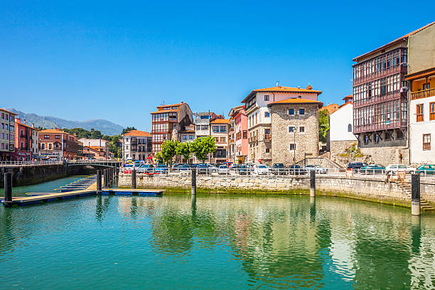 Small town waterfront buildings. Llanes, Spain. stock photo