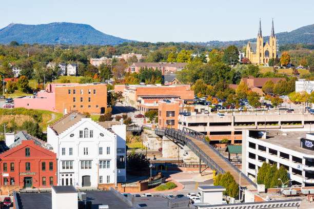 Small Town With Buildings, Rooftops And St. Andrews Catholic Church In The Background -- Roanoke Virginia stock photo