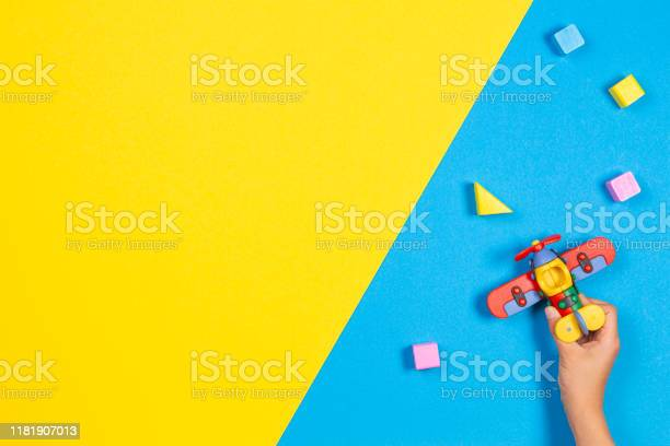 Small toy plane in kid hands and colorful wooden cubes on blue and picture id1181907013?b=1&k=6&m=1181907013&s=612x612&h=ux0hcwrfhvqwdimhpvzbklxdl qmdgfqynrtrvlqhus=