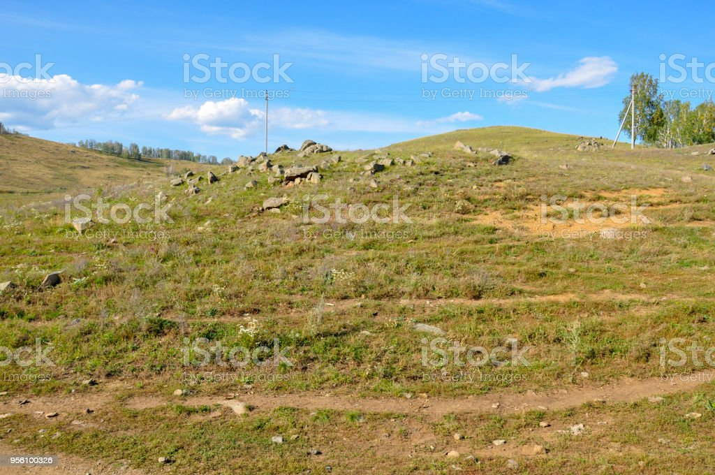 Small track far away to the settlement in summer mountains stock photo