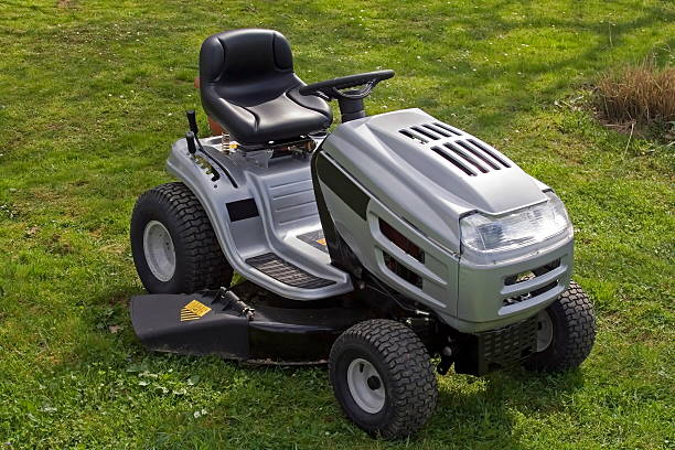 small tractor - riding lawn mower stock photos and pictures